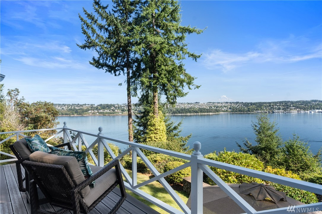 VIEWS, LOCATION, PRIVACY, LIFESTYLE...wrapped in a perfect package to make your heart sing!  Bask in all day sun, enjoying BREATHTAKING, unobstructed 180 degree views from Narrows Bridge to Olympia w/ Mt Rainier center stage.  Watch eagles soar as boats large & small meander through a majestic sun or moon rise over Rainier.  Nearly 2 private acres, incl 433 ft at the waters' edge JUST 5 mins to the Bridge or Uptown.  The storybook home & gardens are in pristine condition..a dream come true!