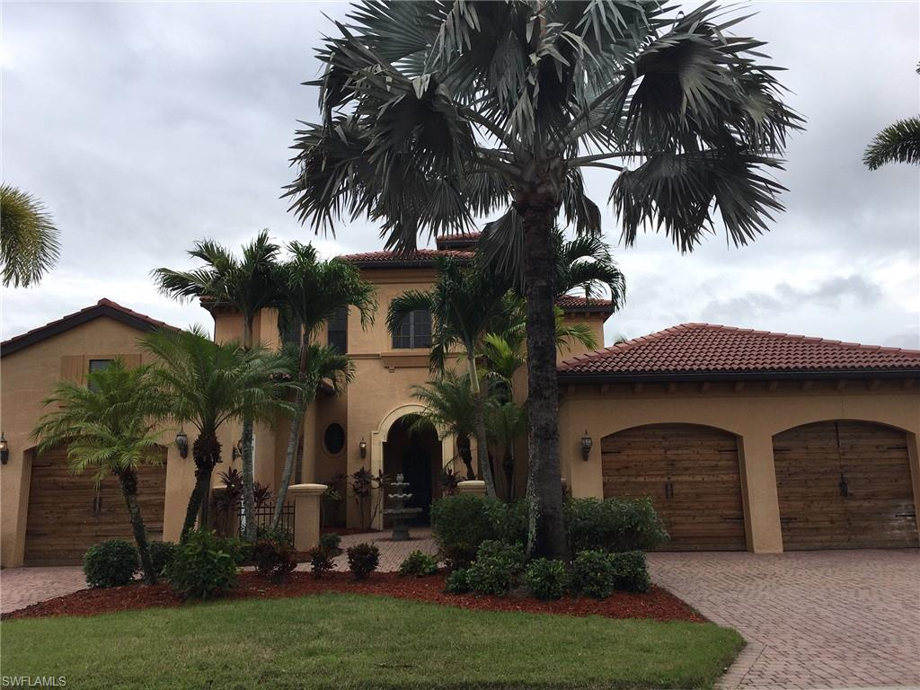 Stunning former model home looks like your own personal tropical paradise!  This gorgeous custom built home is nestled by stately palm trees and mature landscaping.  Rear view offers wide lake panorama with soothing fountain.  Pool also has spa spillover for all the sounds of a serene, private and peaceful setting.  Estero Palms is the little known gem centrally located with easy access to parks, malls, airport, schools, shopping, businesses and I-75 yet tucked away in a secluded, gated enclave.  $108.00 low monthly HOA dues make this the bargain buy in luxury home living.  Quiet cul-de-sac of only 16 homes on this street.  This bank-owned property is a MUST SELL IMMEDIATELY opportunity for one lucky buyer. Features include:  front fountain in courtyard entry, solid wood doors, central vac, wrought iron banister, wiring for theater room, custom crown and trim molding and granite windowsills.  A truly majestic home.  Bank Seller is offering Financing.  Call for details.