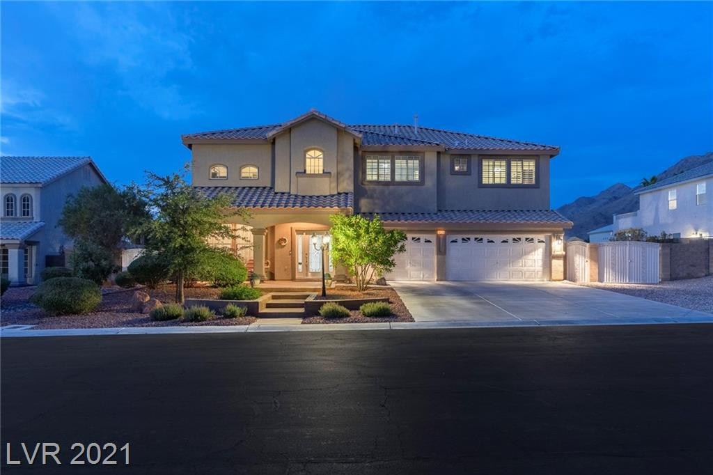 Residence has been impeccably maintained & upgraded with a fresh modern appeal. Located in the Solitude Gated Community on .5 acre w/RV parking & 3 car garage.  It's a must see. Beautiful architecture w/upgraded flooring, lighting & custom window coverings. Open gourmet kitchen. Great for entertaining w/professional grade gas cooktop, double ovens, soft close cabinetry, granite countertops, deep sink & pantry. Functional floorplan as spacious family rm w/fireplace & adjacent formal living rm & dining rm ready to host gatherings. Lrg bedrm w/walk-in closet on main level. Laundry/Mud rm has separate outside door. Master suite w/balcony the whole length of the house & spa like bathrm w/soaker tub, shower, his & her vanities & walk-in closets. Entertain all year long under covered patio. One of a kind resort style pool shaped like a ship w/tube slide, rope swing, hot tub w/waterfall.