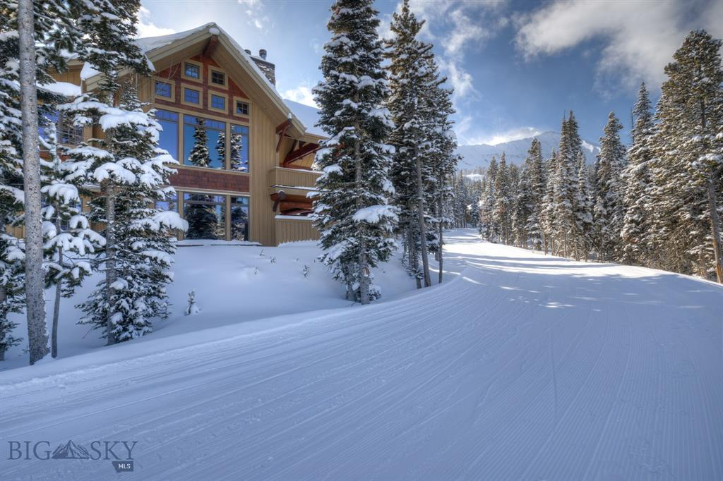 Superb ski-in, ski-out location for this 3 bedroom, 3.5 bath Luxury Suite. Open the door of this remarkable Luxury Suite and enter a world of rustic elegance and warmth. Marvel at the detail and care that was taken in making this a rare and exquisite mountain retreat. Gorgeous hardwood floors and beautiful interior rock work add to the beauty of the gourmet kitchen and living area of this hard to find property. This 3 bedroom, 3 1/2 bath suite has plenty of open space to entertain family and friends. The designer baths with their slate and granite flooring and countertops add to the overall beauty of this property. In addition to all of this, enjoy ski-in, ski-out access to the slopes both Moonlight Basin and spectacular views of the Spanish Peaks.