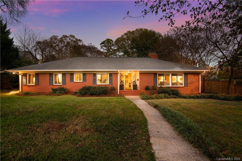 Welcome home to this updated sprawling Myers Park brick ranch on a 0.53-acre corner lot. This 4-bedroom, 2-bathroom home features a fully renovated kitchen with a breakfast bar that opens to a flexible den/sunroom/workspace. The master suite features two closets, an updated bathroom with double sinks, and a large walk-in shower. This home has special details like the sliding barn door to the walk-in pantry/laundry, the Nest thermostat and doorbell, the 2015 tankless hot water heater, and the 2015 updated electrical panel. The exterior has plenty of room for storage with the 2-car detached garage, additional parking space for 4+ cars, and a private patio perfect for entertaining guests. Conveniently located minutes from shopping and restaurants at Park Road Shopping Center, SouthPark, Cotswold, Myers Park, and Uptown. Come and take a look today.
