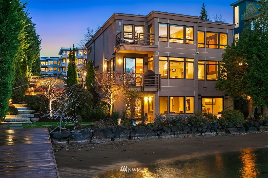 Welcome to your luxury waterfront oasis in the heart of Kirkland. Fully remodeled with a premium location that includes 75' of private waterfront and a 110' private dock. With 4 bedrooms and plenty of space for the everyone, this home has it all. Soak in the lake and mountain views from the chef's kitchen and open concept living on the main floor. Master suite with terrace overlooking the water and 2 additional bedrooms on the same level. Home office, theatre room, and rec room on the lower level. Chic, modern lines, and high-end finishes throughout. Stunning western sunsets from every viewpoint of the home. Beautifully landscaped yard and beach. Easy access to amenities, award-winning schools, and quick commutes to Bellevue and Seattle.