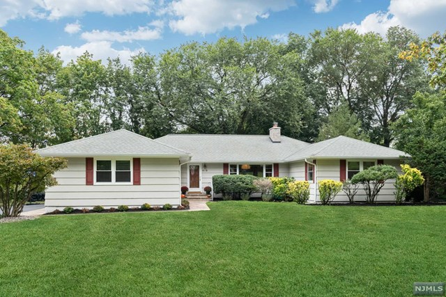 Sitting on 1/3 acre, set back from the road, is this beautiful move-in-ready ranch only minutes away from Glen Rock's adorable downtown shops, restaurants, train station, and top-rated schools. Bright and spacious floorpan with almost 2200 sq ft offers easy living! Hardwood floors throughout.  Large and bright living room with wood burning fireplace. Master bedroom ensuite with views of the backyard, 2nd bedroom w/ private 1/2 bath, 3rd bedroom is very large with 2 closets.  Bright and spacious kitchen, formal dining room, relaxing den/family room off the kitchen with views of the backyard.  Partially finished basement for the extra space one might be craving!  There is a large finished room, storage space, utility room and laundry area.  2 Car attached garage, large driveway, In-ground sprinklers, central a/c, central vac, level backyard with bocci court.  Thank you for showing!