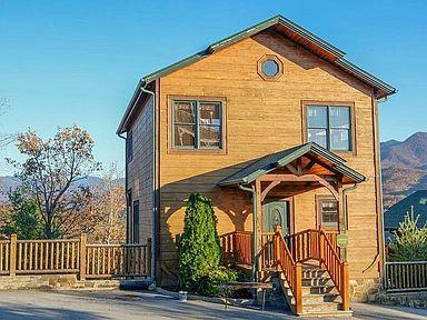 Wow what a cabin! Beautiful log cabin in Gatlinburg Falls Resort. Glorious mountain views & less than 5 minutes away from downtown Gatlinburg. 3 Master suites plus 2 additional  half baths. Currently sleeps up to 14 guests.  Private home theater features 8 cushioned theater seats with built-in drink holders and a large space in front that's perfect for pillow pallets. Big screen TV and surround sound.  Stone stacked gas log fireplace in living room, fully equipped kitchen and a ton of amenities make this cabin a heavy hitter on overnight rental grossing over 70k in 2020 on overnight rental. Resort offers a fabulous outdoor pool and clubhouse. Come see it today!