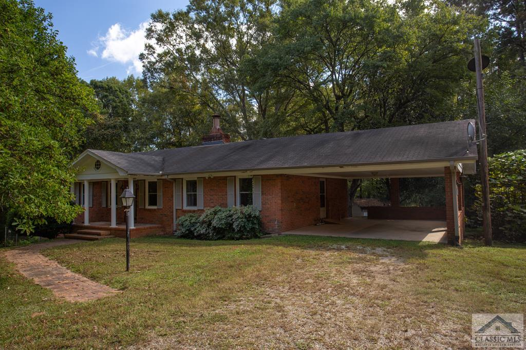 Enjoy a unique opportunity to own over 11 acres in the middle of Athens right off Timothy road. Minutes to shopping, nightlife, and entertainment while still being tucked away from it all. Perfect for potential development or to be a hideaway in the heart of the Classic City. The 4 sided brick home is packed with potential and offers over 3,000sqft and a handicap-accessible basement apartment. Outside you will find 11.17 acres with a large workshop equipped with power and water along with 3 mobile homes. 285 and 287 Woody Dr are being sold together and AS-IS with no disclosures.
