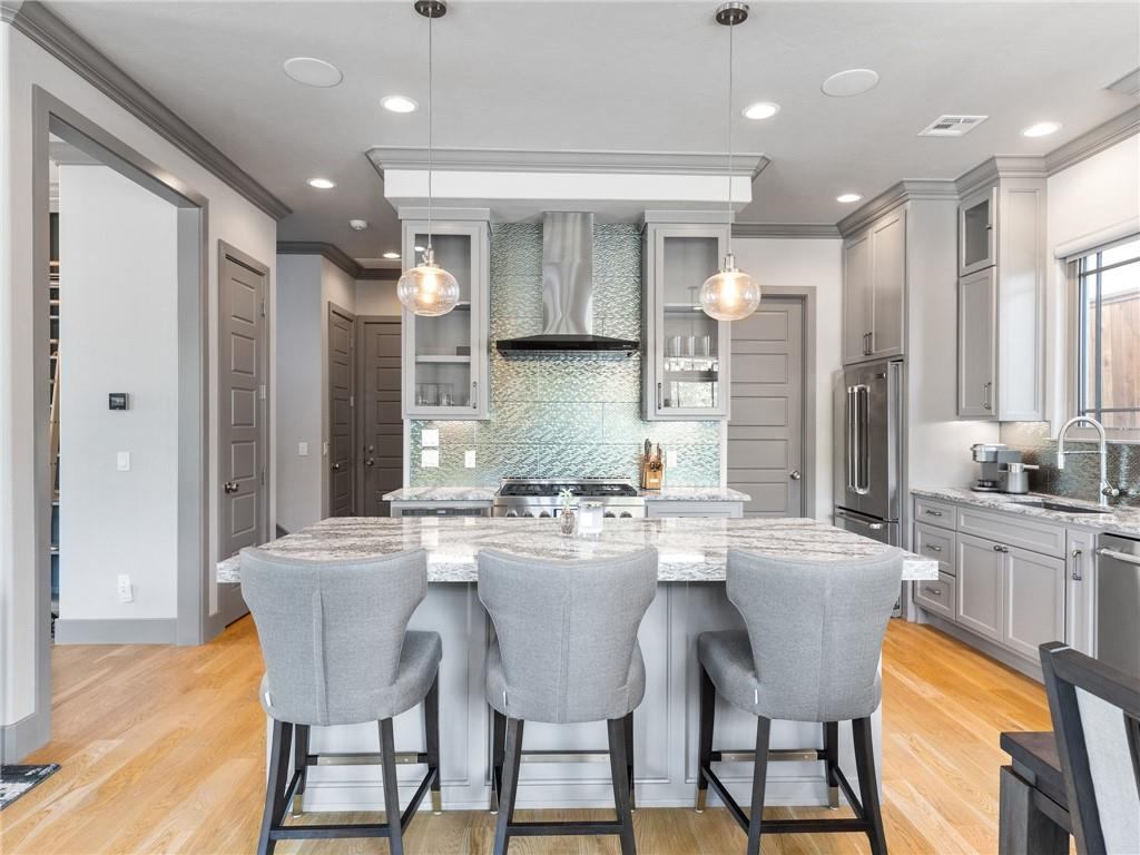 This Beautiful freestanding home was built in 2017 and is located in The Western District. Step inside and prepare to be captivated by the main living area offering stunning hardwood floors, custom built-ins and an inviting fireplace. This control 4 smart home is equipped with JennAir appliances, tankless water heater, Cambria quartzite countertops and more! The flexible floor plan offers two bedrooms upstairs with a third option perfect for a flex space or an additional bedroom. Enjoy a spacious primary suite complete with a sitting area, a large walk-in closet with Washer and Dryer hookups, and an en suite bath featuring double sinks, multi-head shower system, heated floors, & built-in TV behind vanity mirror. Additional features include a 2 car garage with epoxy floors, a balcony and a fenced in yard for the pups! Don't miss your chance to be a block away from some of OKC's best food and retail. Set up your tour today!