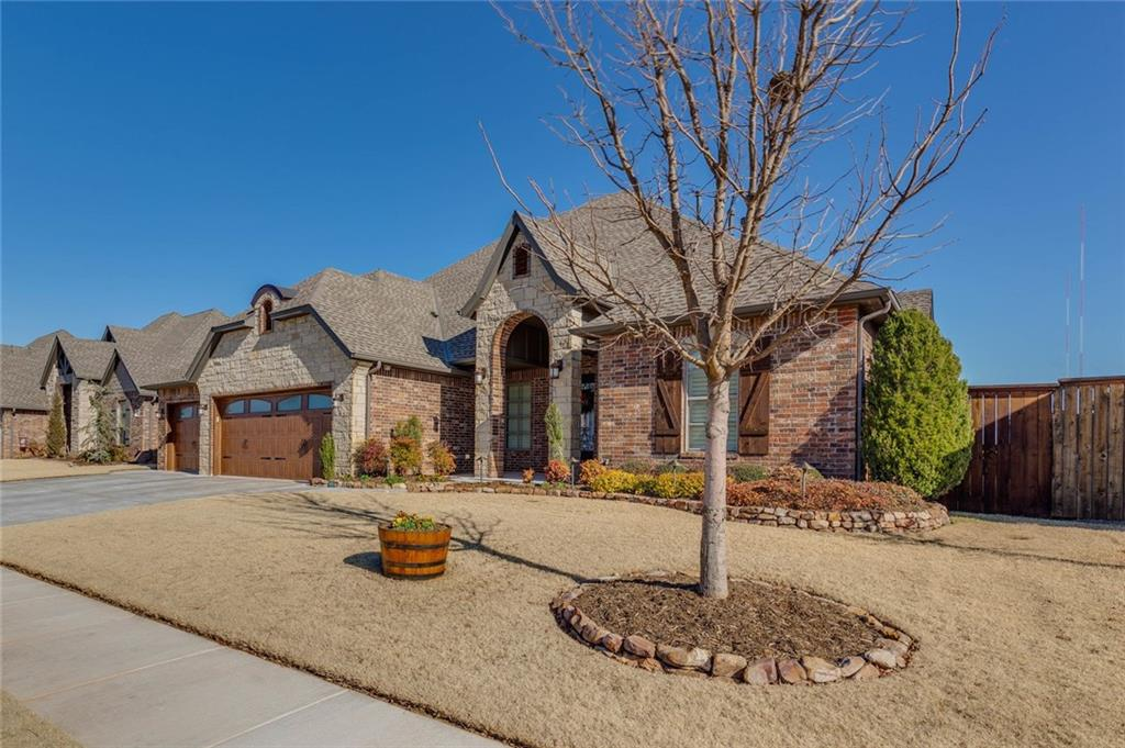 Offering luxury, prestige, & security in gated community w/ponds, community pool, clubhouse, & basketball court. This 5 bedroom home has the master & 2 bedrooms down, & 2 up w/bonus room w/surround sound speakers & built in wired media cabinet w/slide out shelves. Exterior: 4 security cameras w/DVR, custom wired landscape lighting w/timer, backyard w/motion sensor flood lights, sprinkler system, & covered back porch w/gas tap. Interior: Reverse Osmosis System, whole home water filter & softener, new WH, central vacuum w/hide-a-hose system, foam insulation, Honeywell smart thermostats, granite counters, wood flooring, crown molding & extra-wide baseboards, & plantation shutters. Kitchen has Pot-filler, LARGE pantry, auto-opening trash cabinet, custom stained cabinets w/under & over cabinet accent lighting, Frigidaire Gallery series SS appliances, kitchen sink w/built in soap dispenser & disposal, custom backsplash placard & vent hood above cooktop. In home safe room/tornado shelter.