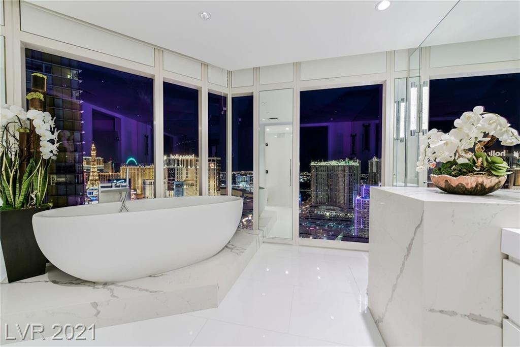 TRULY ONE OF A KIND CUSTOM RESIDENCE w/ THE VERY BEST VIEWS IN WALDORF ASTORIA!!!  BREATHTAKING MODERN DESIGN FEATURING PANORAMIC VIEWS OF ENTIRE LAS VEGAS STRIP.  STUNNING TOP OF THE LINE FINISHES FROM FLOOR TO CEILING OFFER THE ULTIMATE IN LUXURY LIVING. SPA LIKE BATHS w/ SOAKING TUBS, WALK IN SHOWER & OVER SIZED WALK-IN CLOSET. UPGRADED KITCHEN w/CUSTOM CABINETRY, CUSTOM LIGHTING!!