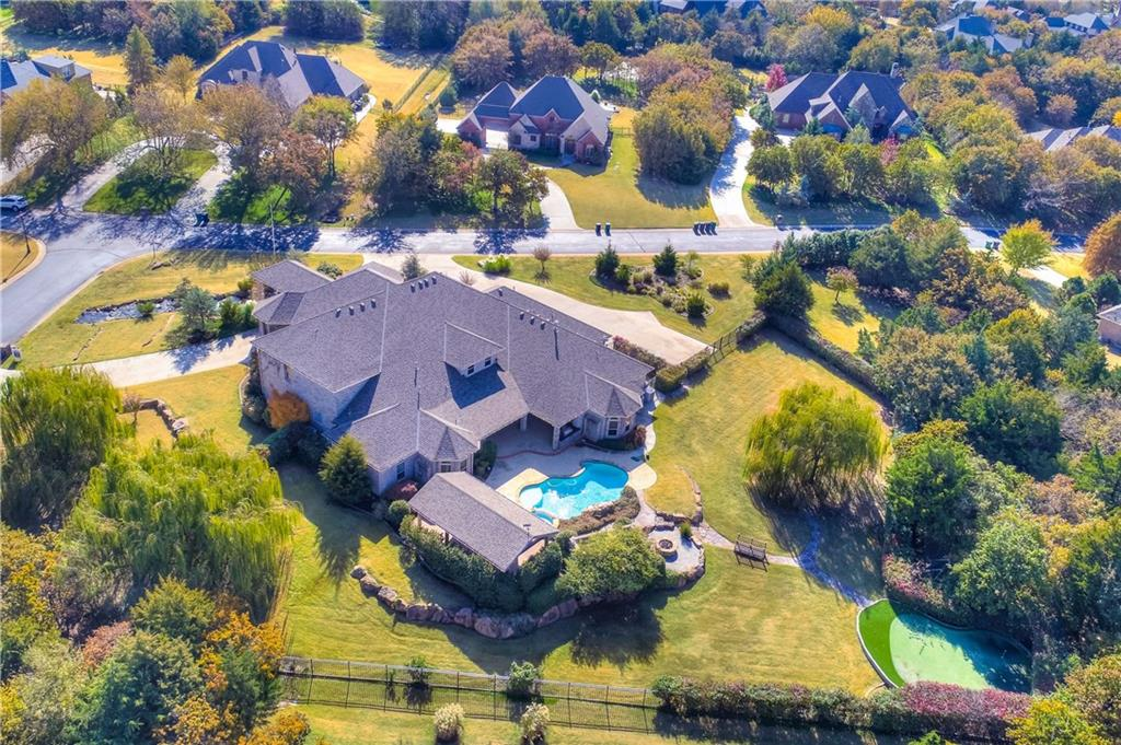 """""""FORMER HOME OF RUSSELL WESTBROOK AND RECENTLY REMODELED"""" with lots of updates!  2 Master bedrooms and guest bedroom on the main level.  Large open concept kitchen/dining/living space.  Kitchen equipped with 2 islands and sub zero fridge/freezer and a large walk in pantry.  Storage galore throughout the home.  Large bonus room upstairs with kitchen/bar area.  Theatre room, exercise room and a second study upstairs.  Putting green in the backyard.  Beautiful pool and hot tub!  Large cabana outside.  Great location to get downtown or to shopping.  Oakdale Schools!"""