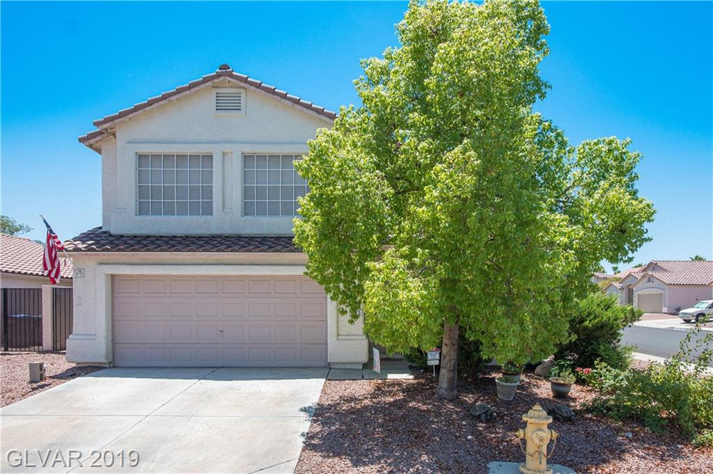Beautiful, well-kept home on large corner lot in a quiet Henderson neighborhood.  Nearly 2000 sq ft w/ an open floor plan that includes an over-sized family room, spacious kitchen, & large landscaped yard w/ patio.  Beautiful tile flooring in kitchen.  Large loft on second floor for the kids or an office!  Minutes from Heritage Park (walking trail, aquatic park, bark park, soccer fields & senior facility).  This beauty won't last long!