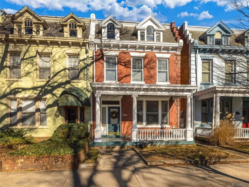 Welcome to 2814 Ellwood Avenue.  Just steps away from Carytown, the Virginia Museum and The Fan this wonderful rowhouse is ready for your special touches.  A light filled entry hall features corinthian columns, beautiful raised panel wainscoting and lovely hardwood floors. The formal parlors have the original pocket doors and lovely fireplaces.  The large dining room also has a lovely fireplace and leads to the butler's pantry and half bath.  Upstairs there are 4 spacious bedrooms all with hardwood floors.  The front three bedrooms have fireplaces and the rear bedroom has a balcony overlooking the rear garden.  A 2 car detached garage is the icing on the cake!  Don't miss this opportunity to make this property your own.