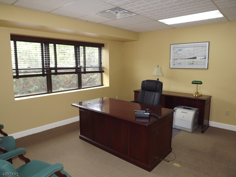 Upgraded professional office space in conveniently located Hastings Square.  Second floor unit. Plenty of on-site parking.  Reception area, kitchen area, and individual offices. Perfect location to expand or relocate your business.  Truly move in condition!