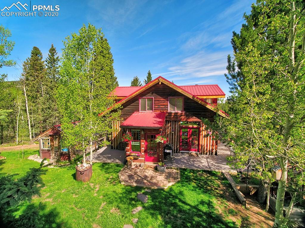 This 16.78 acre property features a lovely cabin, barn, quaint greenhouse and private lake that is habitat for native brook trout.  The cabin, surrounded by ample aspen and pine, was built in 1980 with logs hauled from nearby Copper Mountain.  The builder used beams, doors, and architectural details from the mines, homes and businesses that had been demolished within the Cripple Creek mining district giving this home an historic feel.