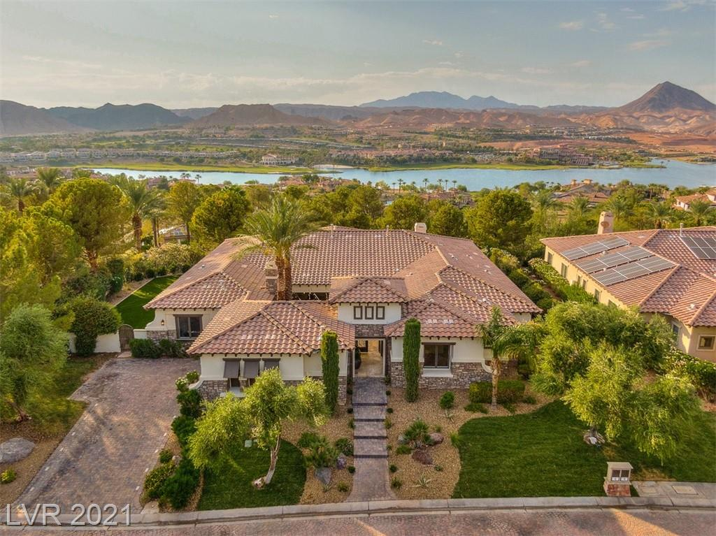 Wow! Incredibly remodeled single story in guard gated South Shore community at Lake Las Vegas. This 4 bedroom+den, 4 bath, 2 car garage pool home is an absolute MUST SEE! Just completed renovations include brand new custom double stacked kitchen cabinets and counter tops, tastefully reimagined bathrooms, Italian ceramic wood plank tile flooring throughout, new landscape, new lighting and plumbing fixtures and so much more.  A wonderful open concept layout of the home is spacious and functional. Situated on a great elevated corner lot with oasis like backyard, you can enjoy the infinity edge pool facing the lake, a large covered patio, and additional bonus side yard with all new synthetic grass that gives you plenty of space to entertain or run around.  Minutes away from restaurants, grocery store, hotels, outdoor water activities, hiking/biking trails and only  roughly 30mins from the strip.