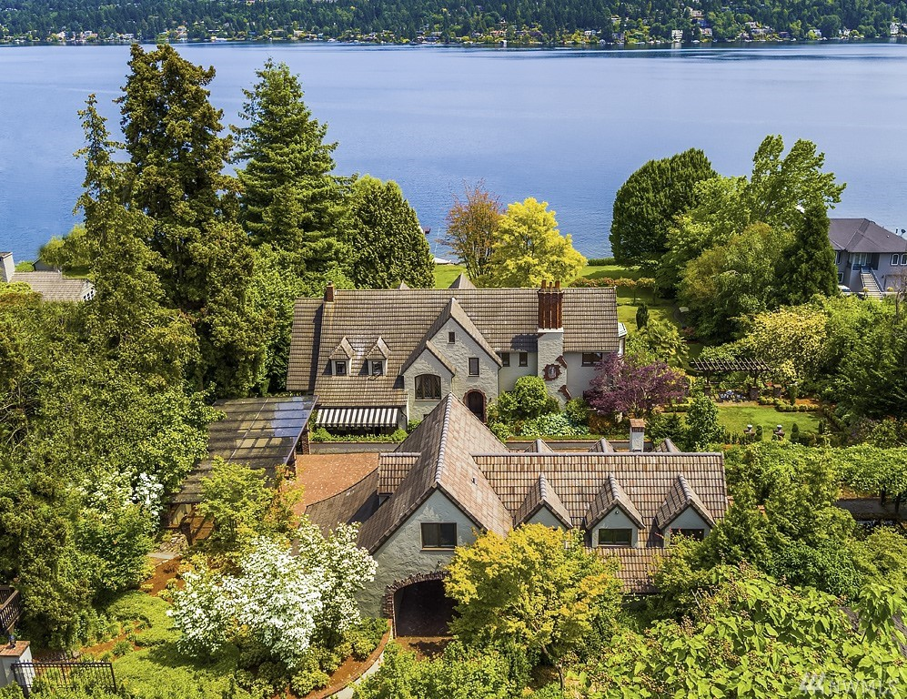 WillowDon-A once in a city opportunity! Gated and private in-city-estate affords nearly 2 acres of remarkable Olmstead Gardens and 174 ft of Lake Washington sandy shores. Fully restored Arthur Loveless home updated with cutting-edge technology. Day rooms for entertaining, retreat to media or multiple terraces amidst Mt. Rainier views. Stuart Silk 2012 guest house and brick auto court greets guests. Auto storage for 7 plus heated shop. Lake house, game lawns, spa, vessel moorage with 1.5 docks.