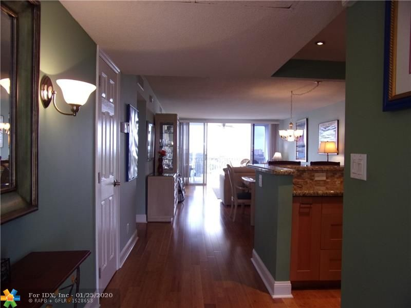 VERY NICELY REMODELED TWO BEDROOM AND TWO BATH 8TH FLOOR CONDO WITH OUTSTANDING AND EXPANSIVE VIEWS! THIS REMODELED HOME HAS BAMBOO FLOORS IN THE LIVING AREAS AND THE SECOND BEDROOM / DEN. THE HUGE WINDOWS AND FLOOR TO CEILING SLIDING DOORS FLOOD THE LIVING ROOM, DINING ROOM AND BEDROOM / DEN WITH TONS OF LIGHT. THE LARGE SCREENED BALCONY HAS PLENTY OF ROOM FOR A DINING AND LOUNGING AREA. THE MASTER BATHROOM REMODEL HAS INCREASED THE BATHROOM BY OVER A THIRD. CHECK OUT THE LONG VANITY AND COSMETIC AREA. THE SELLER WILL SELL OR CONVEY FURNITURE WITH THE SALE. THE LAUNDRY ROOM WITH TWO WASHERS AND DRYERS ARE JUST STEPS AWAY. THIS WONDERFUL HOME IS RIGHT ACROSS FROM THE LARGE HEATED POOL WITH AN OUTSIDE EATING AREA, GRILLE, LOCKER ROOMS AND KITCHENETTE. YOU MUST COME AND SEE THIS GREAT HOME!