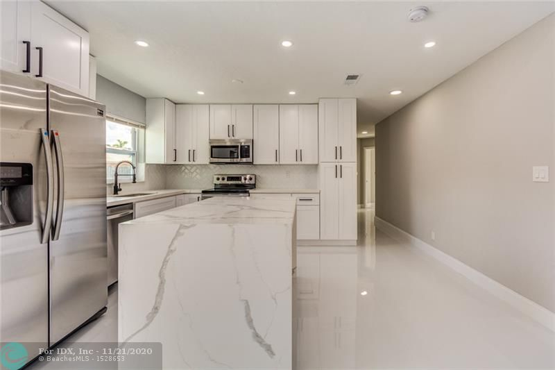 BEAUTIFULLY REMODELED MODERN 4/3 HOME IN LAUDERHILL! NEW HURRICANE IMPACT WINDOWS & BRAND NEW 2019 A.C. ! CUSTOM KITCHEN, BATHROOMS, FLOORING, AND RECESSED LIGHTING THROUGHOUT. KITCHEN FEATURES QUARTZ COUNTER-TOPS AND BRAND NEW S/S APPLIANCES! FRESHLY PAINTED INSIDE & OUT + BRAND NEW LANDSCAPING AND SOD! HURRY, THIS HOME WILL NOT LAST.