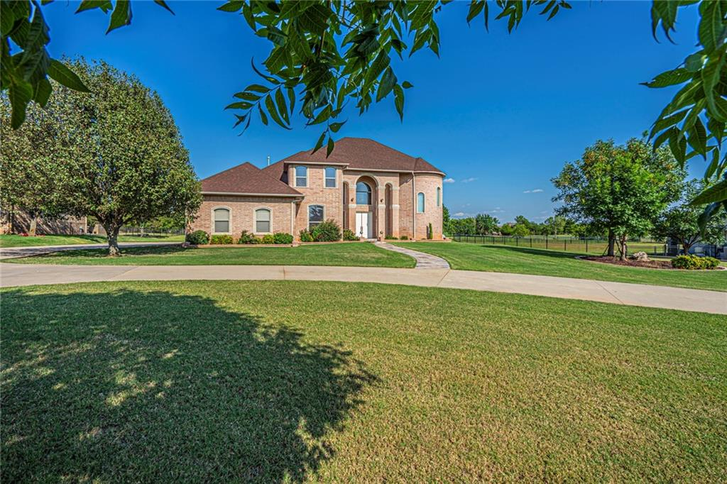 This stunning contemporary custom home sits on 1.76 acres mol in the beautiful gated Olde Stonebridge addition! Perfect for entertaining with its circular driveway, open concept main floor living area that boasts wood floors, curved archways with columns, crown moulding, surround sound and a fireplace. Majestic staircase with awesome views from the stair balcony.  Lots of windows make it light, bright & airy.  Kitchen has SS Viking appliances, custom cabinetry, pantry, butlers pantry & large breakfast bar that is open to the family room.  In addition to your large master bedroom, enjoy a jetted tub, large shower, dual vanities and walk in closet with access to the covered patio.  Two  bedrooms with Jack n Jill  bathroom with separate vanities & one with access to the balcony.  4th bed can be an office with its own bathroom & access to the balcony with beautiful views!  Feels like you're in the country yet close to shopping, highways, schools & Tinker AFB. Desirable Moore schools.