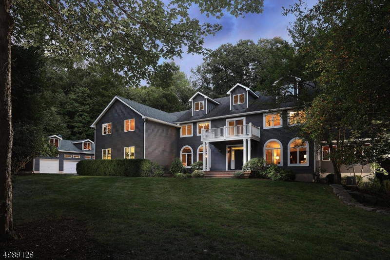 One of a kind, extra special CUSTOM 5BR Colonial is tucked away on a cul-de-sac in desired Warren neighborhood. A nature lover's paradise on 2.43 PRIVATE acres! Plenty of room for a pool. NYC getaway! Car & boat enthusiasts will enjoy the 3 car garage + 3 car detached oversized garage w/ full basement workshop. Gorgeous cherry wood floors & antique pine are thoughtfully placed on 1st & 2nd levels. 9ft ceilings on 1st level, generous sized LR, DR, picture perfect FR w/ FPL & vaulted ceilings, wall of windows, beams milled from trees on the property, Conservatory w/ natural pine finishes, Office w/ FPL. Cook's Kitchen w/ granite counters & high-end SS appls, sunny breakfast rm w/ access to Trek deck & paver patio. 2nd fl MBR suite & renovated MBATH w/sauna & steam shower + 4 add'l BR's + 2nd Office w/balcony.