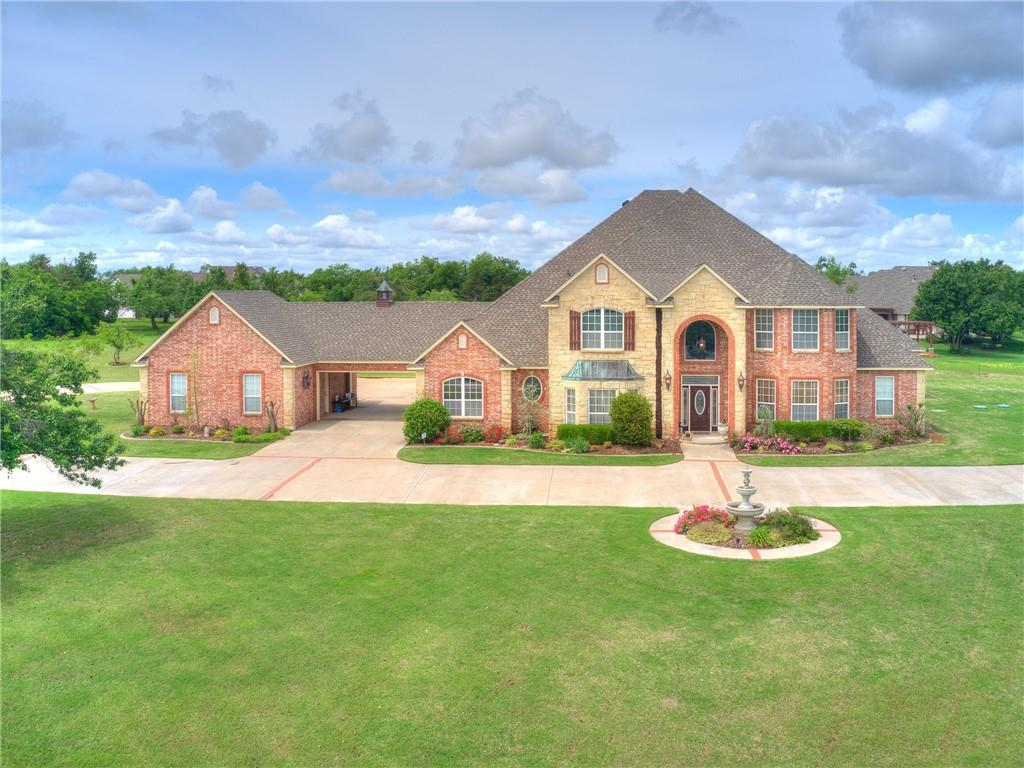 Custom built, Biswell Homes builder personal home.  On 2.2 sprawling acres with wonderful view of the neighborhood lake includes oversized 2 & 3 car garages totaling 1766+ ft, separate dog kennel indoor heated pool and spa.  Kitchen boasts 2 dishwashers, kitchen aid oven, 5 burner gas cooktop & convention microwave as well as built in warming drawer.  Home has extensive storage, oversize rooms and very large walk in closets.  Large library at front of home offers room for grand piano or use as a formal living.  Large study over by kitchen area with built in bookcases and private 1/2 bath allow all the conveniences to work full time from home.  Home is fully equipped with commercial phone switch and intercom system.  Master closet contains walk in storm shelter with safe, dressing area with triple mirrors and more.  Upstairs has 2 large bedrooms, private baths & walk in closets.  Nice media room and open space with built in desks. Class 4 shingle on roof. Downstairs carpet allowance