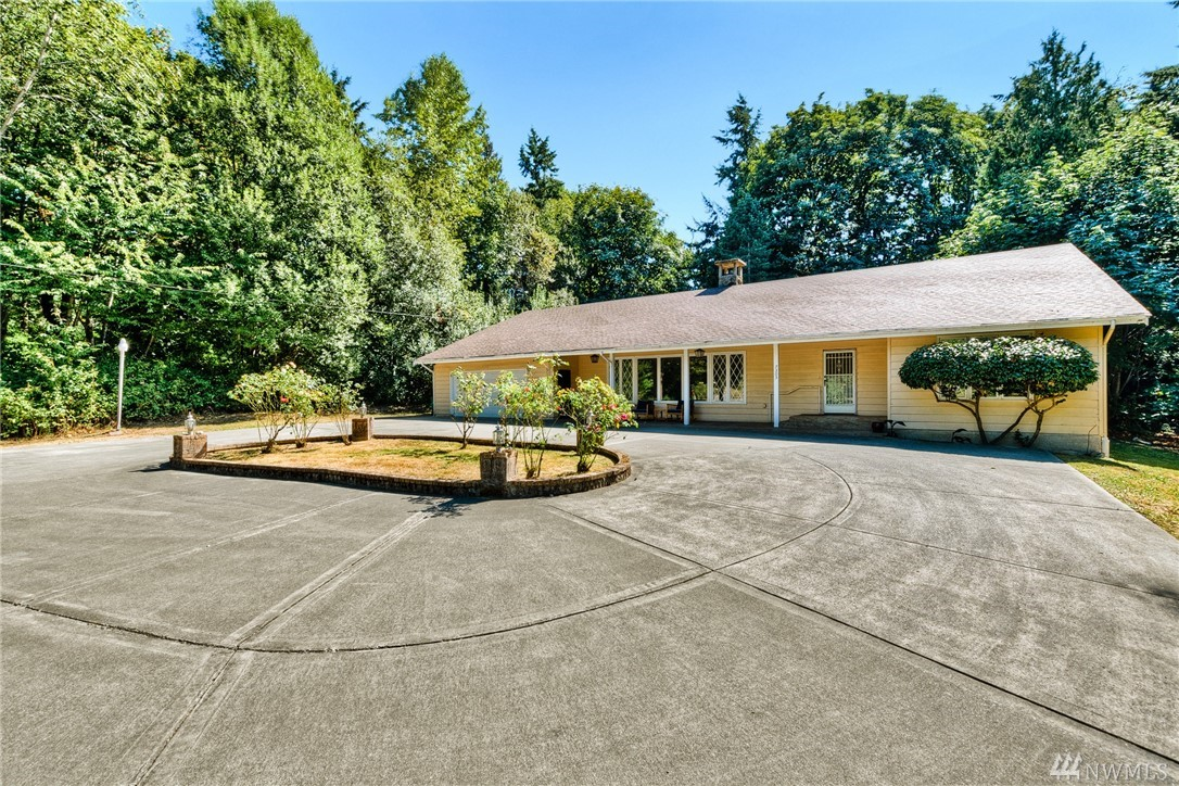 Located on over half an acre, this gorgeous mid-century modern home offers ultimate privacy & a rare opportunity to be outside of the city with easy commutes. Grand entry with roundabout driveway & endless possibilities w/extra space. Bright & open living with a grand room, soaring ceilings, formal dining, & stunning fireplace. Spacious 4 rooms-all w/bathrooms. Impressive main suite w/oversized jetted tub. Newer energy efficient heating/cooling system & renovated bathroom, laundry, & mudroom.