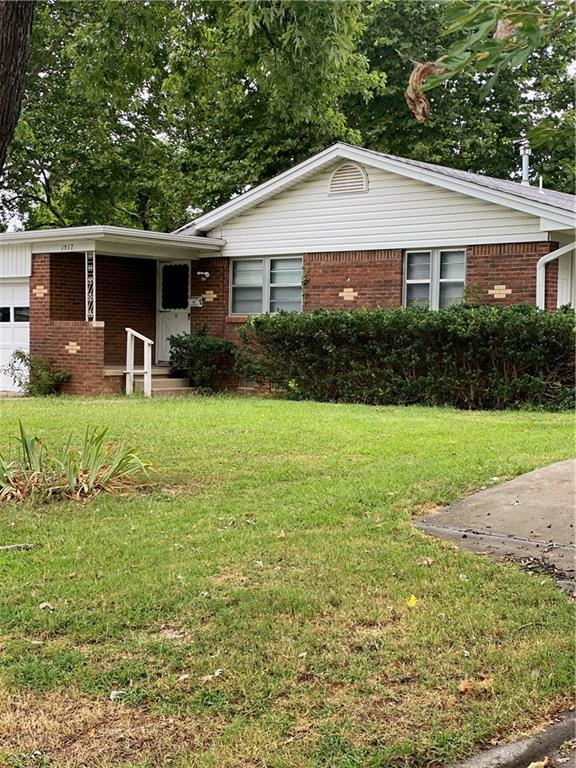Walking distance to OU!   Charming midcentury home nestled in South University Place.  This home features original hardwood floors in excellent condition!  Darling kitchen with side access to back yard.  Original HVAC unit has been replaced as well as plumbing.  Laundry located in garage.  Washer, dryer and refrigerator are negotiable!