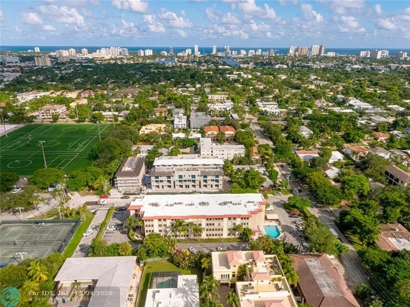 Fantastic Victoria Park location next to the tennis courts! Spacious 2BR/2BA ground floor unit located in La Cancha a boutique residence of only 43 units. With 1020 SF of living features of this home include: a split bedroom plan, well-equipped kitchen with breakfast bar and pantry, an open living to dining area, recessed lighting, crown molding and custom shelving. Residents here enjoy a secure building with a common laundry (owners may install in-suite), a heated pool with patio and cabana area plus a storage room. Situated adjacent to Holiday Park's tennis center at the end of  a quiet cul-de-sac and only blocks to Las Olas and downtown.