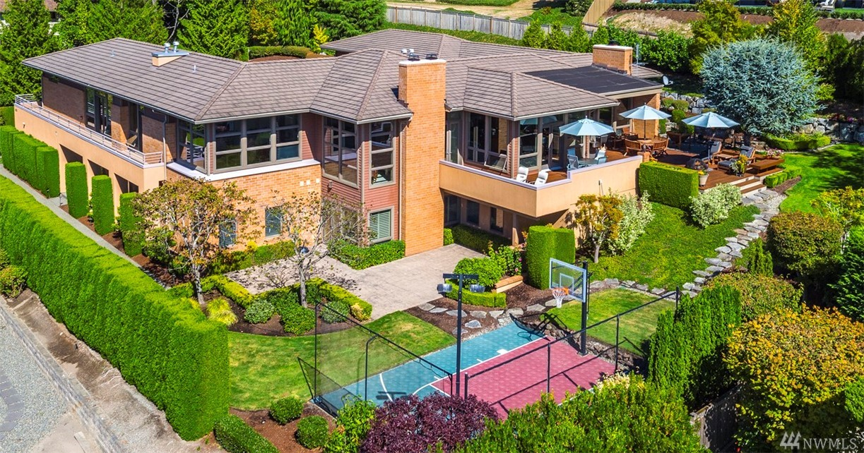 The Best of Northwest Contemporary Style on Clyde Hill! Perched on nearly 3/4 of an acre, this custom estate enjoys mountain, golf course, & partial lake views. Tall ceilings & clean lines create an airy feeling in this open floor plan perfect for entertaining. Have fun cooking w/friends in the kitchen open to the great room. Relax in the private, main floor master suite. Guests will love the lower level apartment w/kitchen. Expansive outdoor entertaining areas & sport court. Medina Elementary.