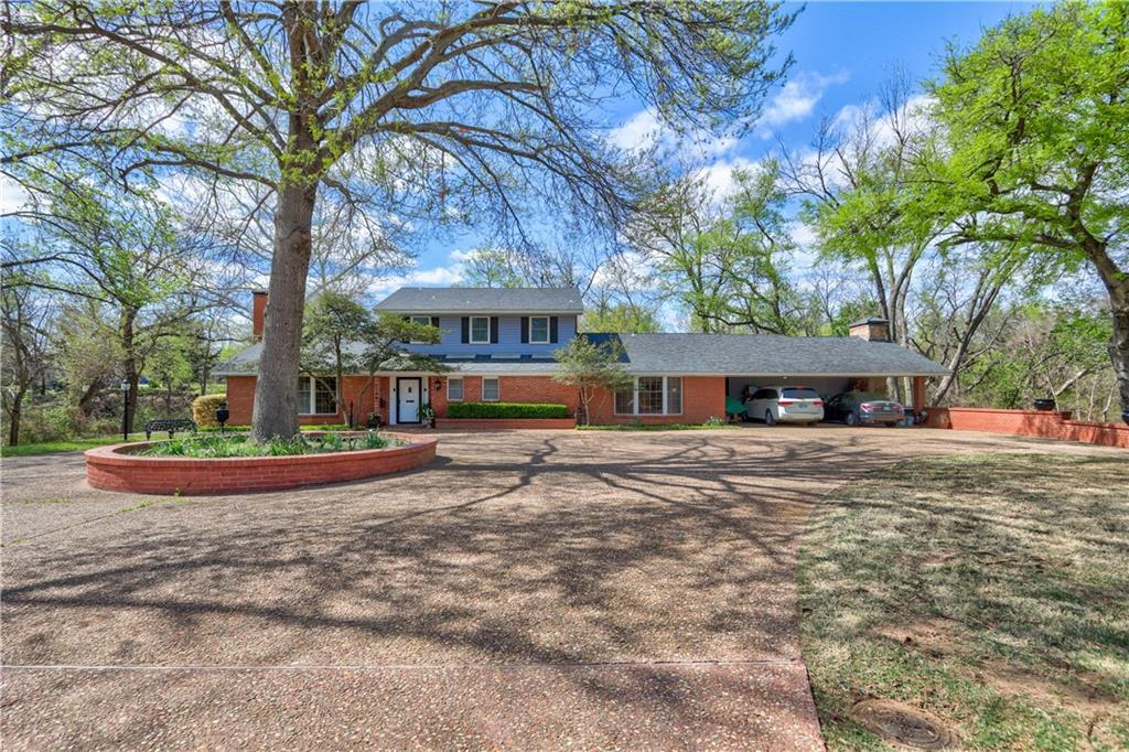 Fabulous location in McKinley school district!  Street ends at a private circle drive with home backing up to the creek and part of the exclusive Lakewood Pool Association. As you walk in the door, you will immediately be drawn in by the character & charm.  Living room has high ceilings and opens onto one of the most magnificent sunrooms you have ever seen! The kitchen is HUGE with storage galore! The laundry room and project room are enormous with wonderful closets and cabinetry throughout. Master downstairs and two bedrooms upstairs with HUGE closets with windows in each. Fourth bedroom or study is downstairs and has its own private full bath, bookcases and window seat.  Down an outdoor spiral staircase is a hidden gem.  It's a basement room with fireplace and bar with plumbing. Walk across the darling red bridge to take a swim...Back up to the house to enjoy a sauna! Come explore this amazing property today!