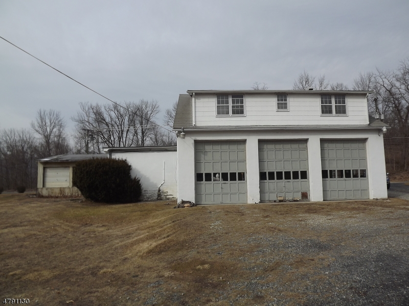 REDEVELOPMENT OPPORTUNITY - 1.28 Acres with 620' frontage on Route 94 and additional 630' frontage on Buchanan Rd. Commercial building (appx 3600sf) on Lot 1 (.56 acres) and 3 bedroom house along with 2 car detached garage on Lot 2 (.72 acres). Zoned Highway Commercial with many permitted uses.