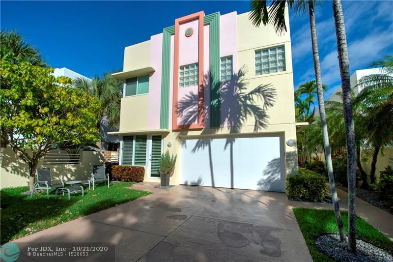 Amazing Colee Hammock location, just 2 blocks to Las Olas! This 2 story Art Deco style town home has soaring ceilings, lots of natural light, beautiful contemporary metal staircase to 2nd floor bedrooms and the 3rd level is an over sized rooftop deck with covered space and views of downtown! The kitchen is updated with granite counter tops, stainless appliances, lg pantry closet and breakfast area. Other features include updated baths, Hunter Douglas blinds,  modern security system, 2 zones a/c, office with built-in desk system and walk-in closets in the Master Bedroom. Secure, walled exterior with gated entry and the garage has built in cabinets and a finished floor.  A must see!