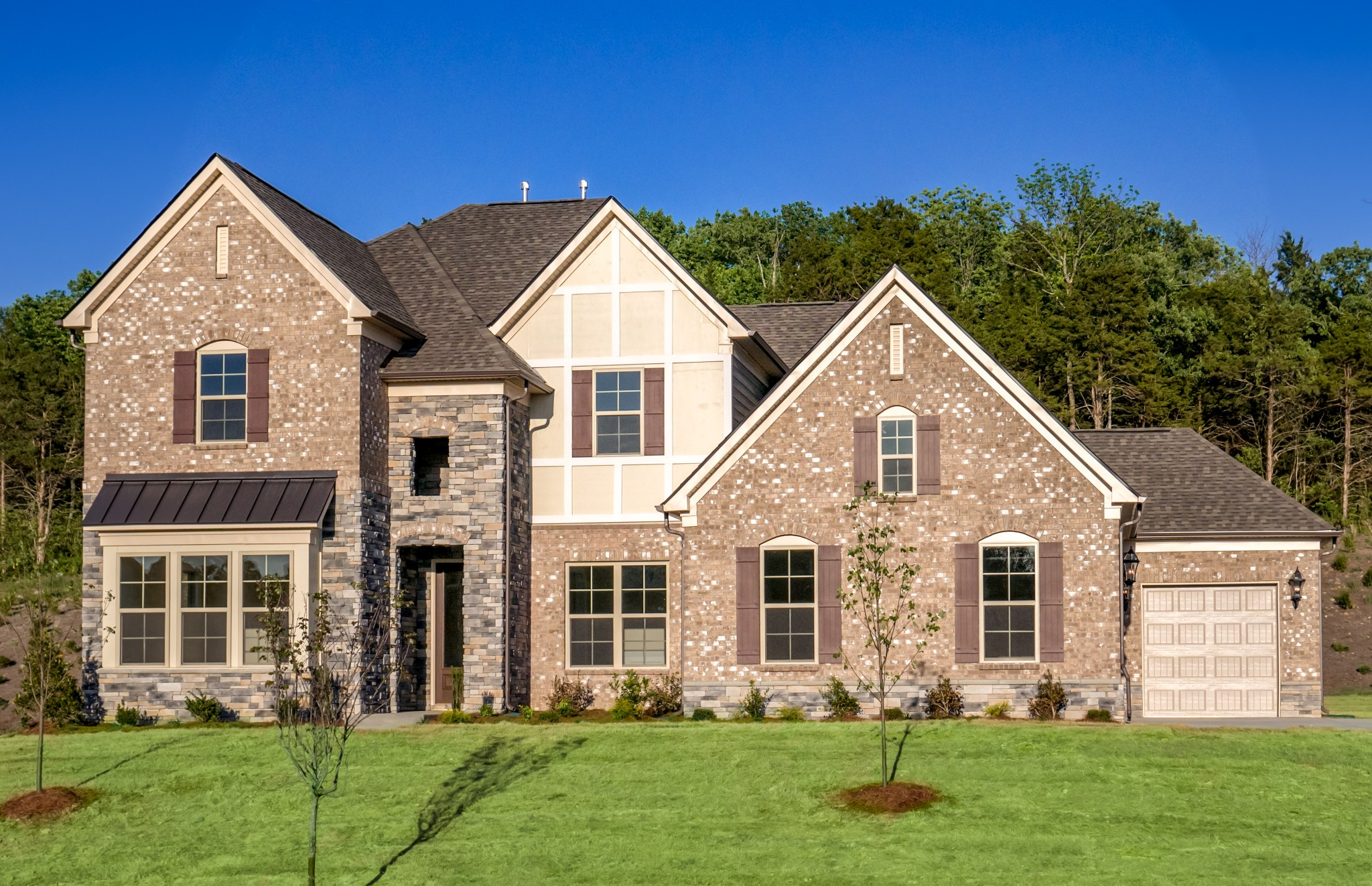 Woodfield floor plan. One of 5 floor plans offered in Taramore. Price includes covered porch, gourmet kitchen, grand master closet, and upgraded owner's bath.