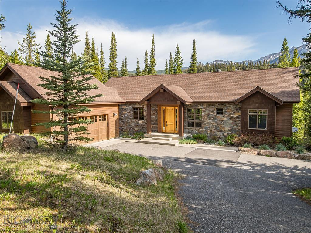 Come see this remarkable home in the woods with stunning mountain views.  This property offers four bedrooms, three and a half bathrooms, vaulted ceilings, custom upgrades throughout, radiant in-floor heating, theater room, sauna room, and ample patio space for your entertaining needs.  Located on .8 acres in the Aspen Groves neighborhood,  this home is in an ideal neighborhood, located a few miles from Big Sky Resort and Town Center.  Offered turn-key and fully furnished. This lovely home is a must see.  Call today to schedule a showing.