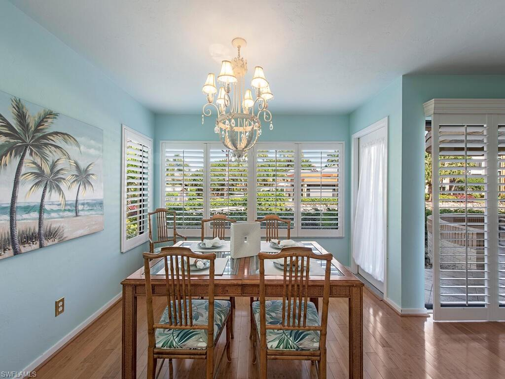 """C1196 - Rarely available first floor corner unit, in the uniquely designed """"Frank Lloyd Wright inspired"""" neighborhood of Interlachen At Pelican Bay. Find yourself in your very own Florida paradise, in this well located condo, just across the street from the Marker 36, and a short tram ride to dining, and basking in the sun on the sugar sand beaches of Pelican Bay. The condo boasts a stunning view of a serene lake and lush landscaping. Enjoy the view from the open air terraces located around the perimeter of the the unit. Stainless Steel appliances, plantation shutters, updated flooring in both bedrooms. The Pelican Bay Fitness Center offers first-rate equipment and facilities in order to help members achieve their fitness goals. The group exercise program offers classic and unique classes in indoor as well as BEACHFRONT LOCATIONS. Just a short drive to the ALL NEW Club at Pelican Bay!"""