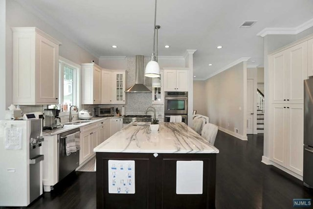 Stunning 5 years young, home offering approx. 3,400 sf (not including finished basement) of luxurious living space in Tenafly's sought after 3 schools district. Modern, open floor plan lends to the bright and airy flow of this sophisticated home featuring 2-story great room with gas fireplace, modern eat-in chef's kitchen with butler's pantry and breakfast area, formal dining room, formal living, powder room. A Large Master Suite with walk in closet plus an additional three bedrooms, two full baths and laundry room complete the second floor. A huge basement with a full bath , bedroom and a recreation room. Generator ready, Hunter Douglas Motorized blinds, walking distance to school and NYC bus!