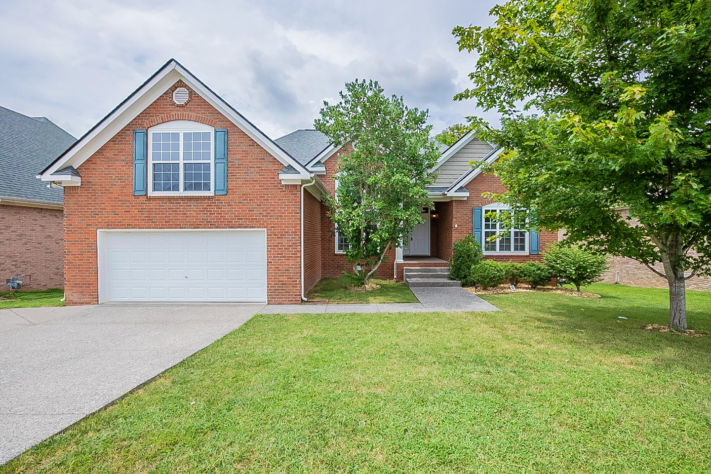 This Spring Hill two-story home offers granite countertops, and a two-car garage.