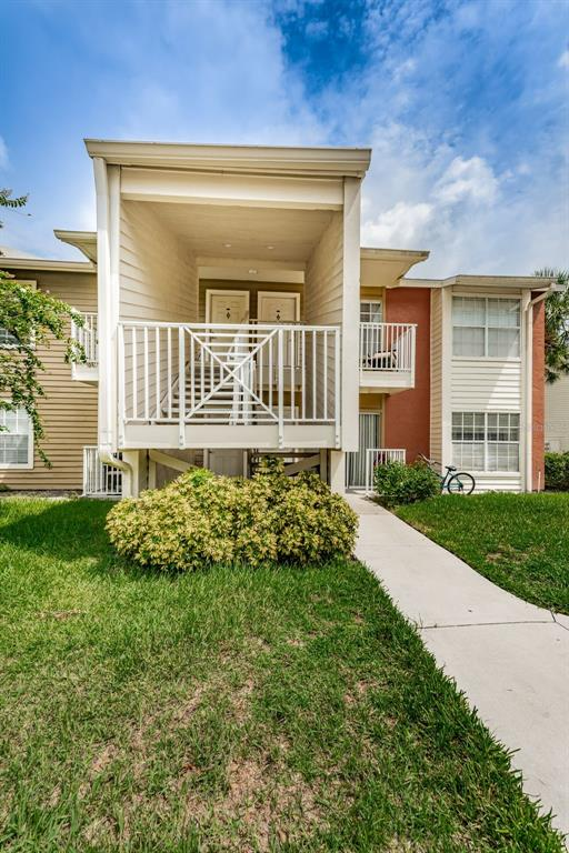 Great 1 bedroom/1 full bathroom first floor, corner unit with inside laundry! New A/C installed Oct 2018! The amenities in this complex are awesome offering a community pool sitting on Lake Hendricks with a spacious pavered deck area that leads to a beautiful dock and gazebo! Plus a fabulous clubhouse/rec facility with a gym/fitness center, kitchen and gathering area. There are also tennis courts and racket ball courts! The entire complex circles beautiful Lake Hendricks and offers a community walking path around the lake- accessible from all buildings. Walk out your door and hop on the lake path! This spacious 1st floor unit is located an easy minute walk to all the awesome amenities. The parking is ample here - park with ease right out front of your unit! This corner/end unit is full of natural light and offers glass sliding doors from your living room to your covered front porch. The layout is great - an open living room area that leads to the kitchen with a breakfast bar and a separate dining room that is lined with chair rail molding. The kitchen offers solid wood cabinets, neutral ceramic tile flooring and all black appliances. The indoor laundry is located in the hall between the large bedroom and full bathroom - convenient! The very spacious bedroom offers a charming window nook and walk in closet. The full bathroom offers a wood vanity and solid surface counter, ceramic tile floors, updated lighting/fixtures and a white tile lined shower/tub combo. Your very low monthly fee of $212.00 covers everything: grounds maintenance, building exterior maintenance, roofs, insurance on building, water, sewer, trash, exterior pest control, property manager, pool & all recreation facility use including gym, tennis and racket ball! The location of this well kept condo complex offers walkability to Brandon Regional Hospital. Plus a large sports complex and the awesome Clayton Park with a huge playground and covered picnic area is just across the street! Perfect location to