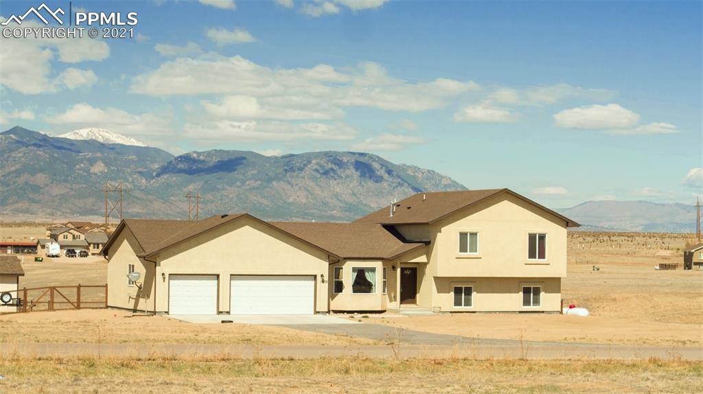 **SEE VIRTUAL TOUR**  This home is better than new and has so much to offer! The main level has an open floor plan with custom tile flooring and plenty of natural light. The spacious kitchen has vaulted ceilings, granite countertops, a gas range, and incredible mountain views. Upstairs you will find a large master retreat with two walk-in closets and a spacious, attached bathroom with marble tile flooring.  It also has two large bedrooms and another full bathroom. The lower level features a large second living area with a gas fireplace, office area, full bathroom, and a large bedroom with an abundance of natural light. The 2 x 6 construction is wrapped with durable stucco making the home extremely low maintenance and energy-efficient. The air conditioning will keep you nice and cool during the day while you can step outside in the summer evenings on the covered patio and enjoy amazing mountain views. This property feels very secluded and private even though you are just minutes from I25 which allows for easy commuting to Fort Carson, as well as other military bases, and Colorado Springs.   The home totals 2344 ft.² with 4 bedrooms and 3 full bathrooms, a three-car oversize garage, and rests on 2.82 acres.  Built in 2019, this beautiful home still feels brand new!