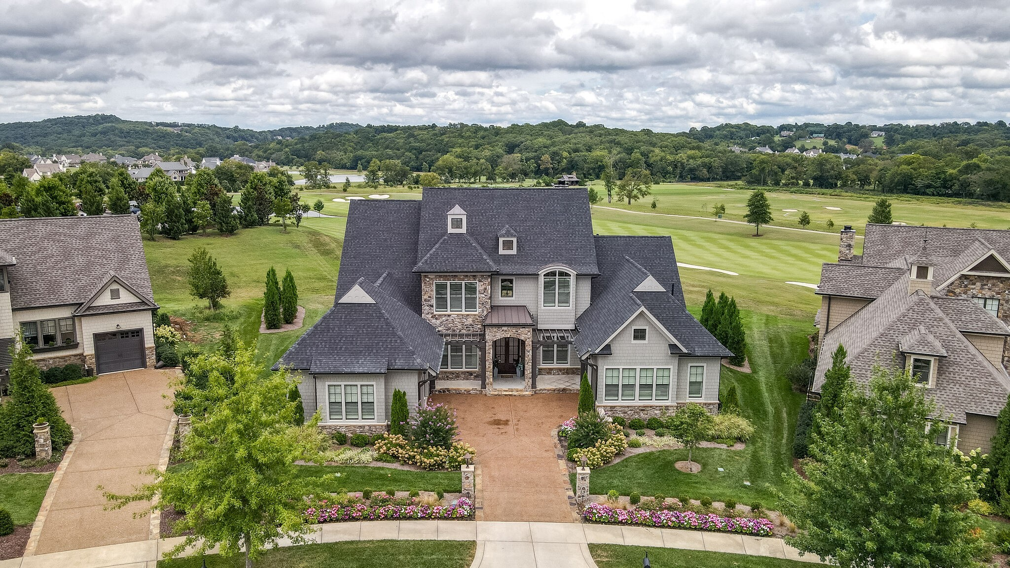 One of a kind location/ golf course home at The Grove! Beautiful Legend Custom Home on 18th fairway w/ fairway, practice area & open space views. Luxurious Owner Suite w/sauna overlooking golf course & distant ridgeline! Soaring Great Room w/ vaulted ceilings, main level game room/lounge, premium appliances, custom built-ins, & even an elevator! Make this home a must see!  Walking distance to tennis courts, pools, clubhouse, general store etc. Golf course homes at The Grove are a veryrare find!