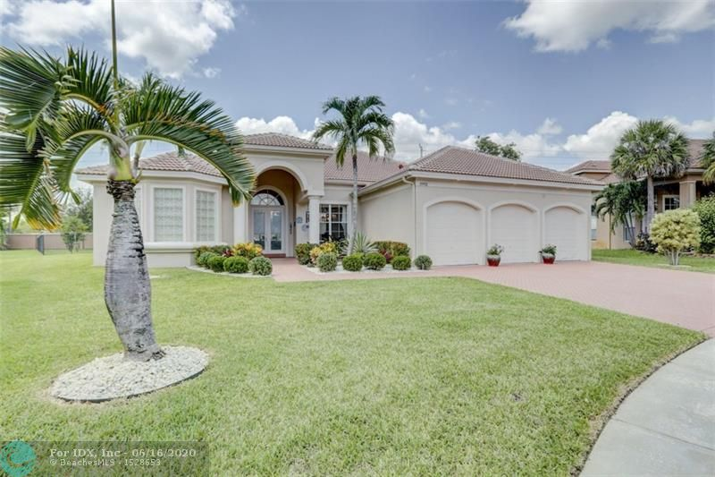 """This impeccable home is located in the highly desired gated community of The Estates of Pembroke Shores.  Situated on one of the largest lots in the neighborhood at 16,262 sqft! Immaculate professional landscape in front and backyard. Fenced backyard with large pool/spa with extended sizeable patio. Brand new tile roof added in May 2020! Open floor concept living area gives this home its impressive appearance. The 4 bed, 3 bath 3 way split allows for lots of privacy. Spacious master suite w/sitting area. Huge master bath w/roman tub, his/hers vanities, plus his/hers walk in closets. Dining areas include breakfast area, snack bar/counter and formal dining room. Trending white kitchen cabinets. Tile, carpet&laminate wood floors. """"A"""" rated schools. HOA fee includes basic cable with Xfinity."""