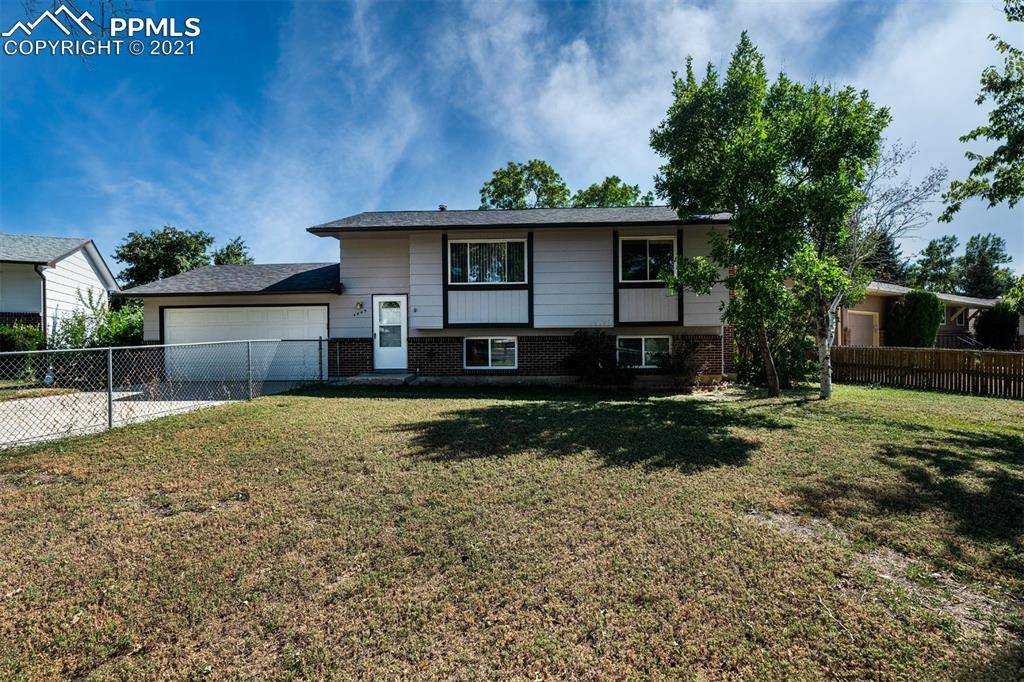 Move in ready, refurbished 3/2/2 Bi-level in Vista Grande on a semi cul-de-sac. Fully fenced, new exterior paint, new carpet + pad, 2nd generation windows, 6 panel doors, Lg trex deck & Lg concrete patio w/ side yard concrete walkway. Newer roof & gutters, LVP flooring throughout M/L. W/O to patio from Lg eating area, replacement cabinets in kitchen, 2 nice bedrooms on M/L + 1 on lower lever, full bath on M/L w/ til surround & 3/4 BA on lower level w/ tile floor & tile surround; window blinds throughout. Lg Laundry room w/ good storage & BIG L/L family room w/ wall-to-wall brick fireplace. Kitchen has newer frig & dishwasher. Close to shopping, eateries & walking distance to schools & park... This one has lots of natural light on both levels... It's good to go!  Note: Buyer agrees to cooperate w/ sellers 1031 exchange.