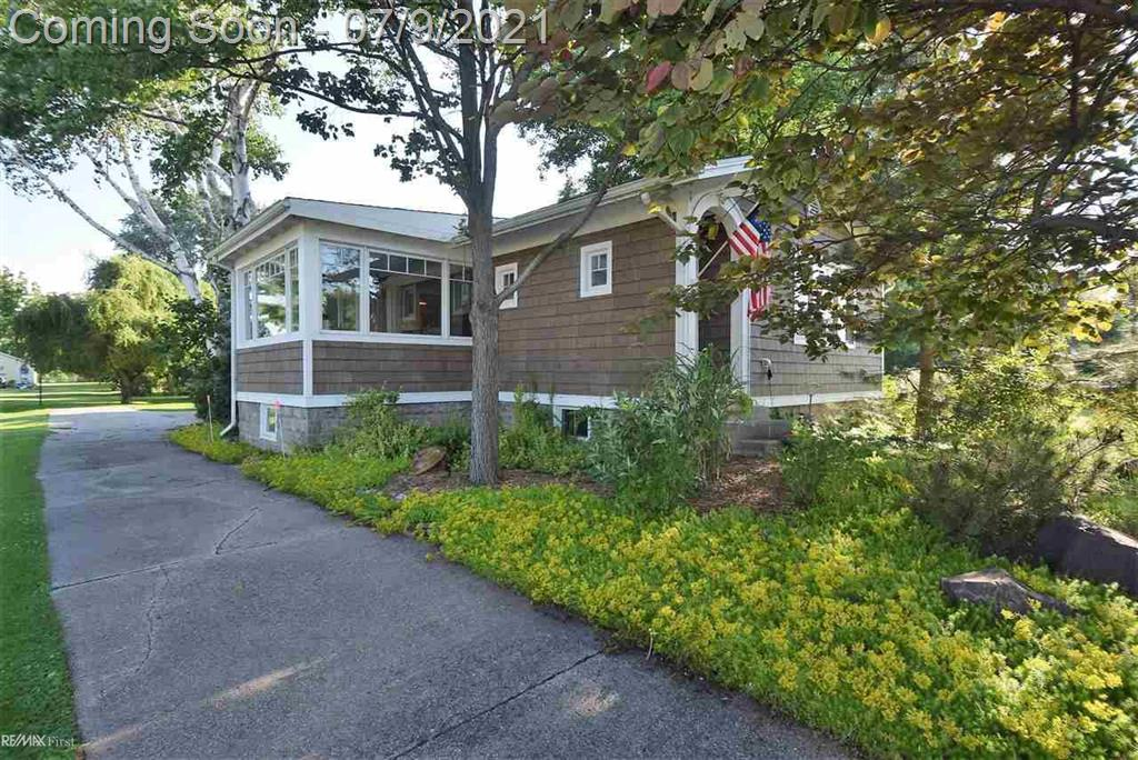 Completely renovated 2-bedroom CANAL FRONT Craftsman Style home w/ (grandfathered) boat house/hoist on deep half-acre lot. Short boat trip past Algonac Harbour to the North Channel of the St. Clair River. One of the few water front homes built on a dry basement - waterproofed w/ 15 years remaining on warranty. Recent updates include Quartz Kitchen w/ Kraftsmaid Birch cabinets, marble bath, exterior siding, roof, plumbing, electrical, MARVIN windows, refinished original wood floors, marble foyer & back porch, and more. No expense spared. Amazing landscape w/ private raised deck, rare ornamentals & orchard. 2-car detached garage AND large shed for storage. Short walk to downtown Algonac w/ shops, restaurants, riverfront boardwalk & all conveniences. Appliances and one year home warranty included. NO FLOOD INSURANCE - seller has filed LOMA.