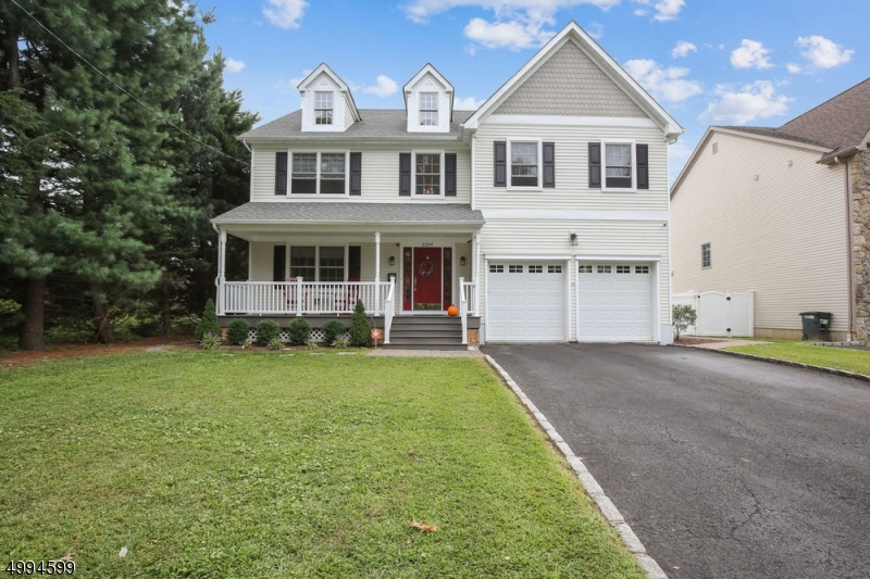 Located in a very desirable neighborhood, this home is STUNNING and MOVE-IN READY. An abundance of living space makes it special but it is the upgrades that make it nearly impossible to resist. Major renovations include a striking gourmet kitchen w/granite counters, breakfast bar & SS appliances done in 2018, completely finished basement comprised of exercise area, rec room, and storage room, Updated front porch with Trex floor, new lighting, columns & railings, professional landscaping & backyard patio with privacy fence, and freshly painted interior. Gorgeous hardwood floors, custom moldings and beautiful lighting grace the formal living and dining rooms.  The kitchen opens to a stunning family room with fireplace & built-in bookcases.  So much to love!