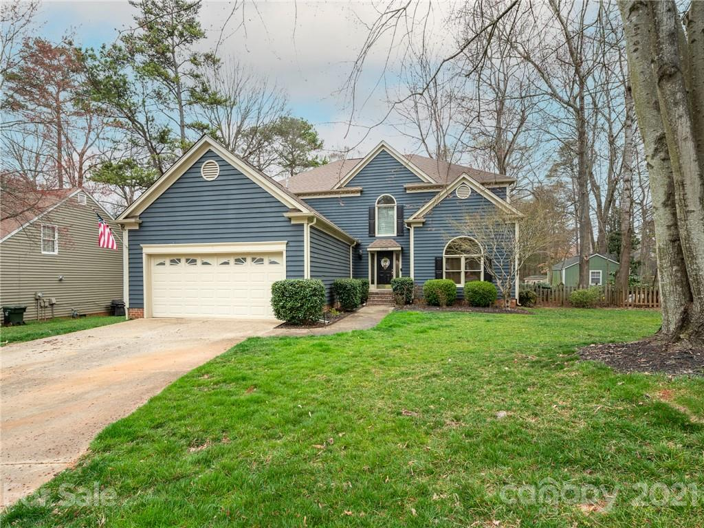You will fall in love with this Cedarfield gem! Main floor features a formal dining room, two story great room, updated eat-in kitchen with breakfast nook, and the owner's suite. Upstairs you will find 3 additional bedrooms and a large loft/flex space perfect.  This home has the perfect back yard with a large deck and screened in porch overlooking the beautifully landscaped fenced yard. Neighborhood features pool, playground, and access to the expanding Torrence Creek Greenway.