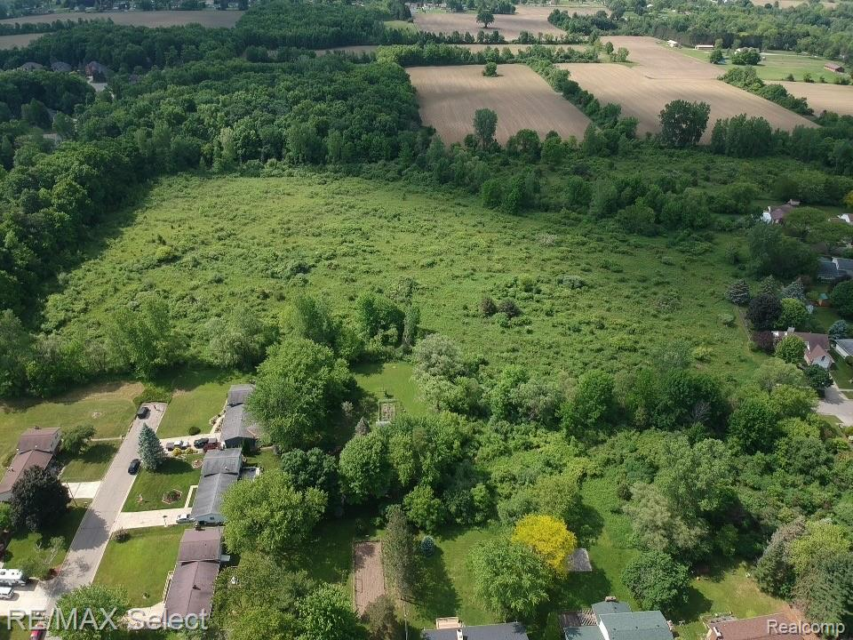 20+ acre parcel located in the city of Flushing is perfect for your own private oasis or for a developer looking to build a subdivision (see photos for previous plans). Water & sewer available at street.