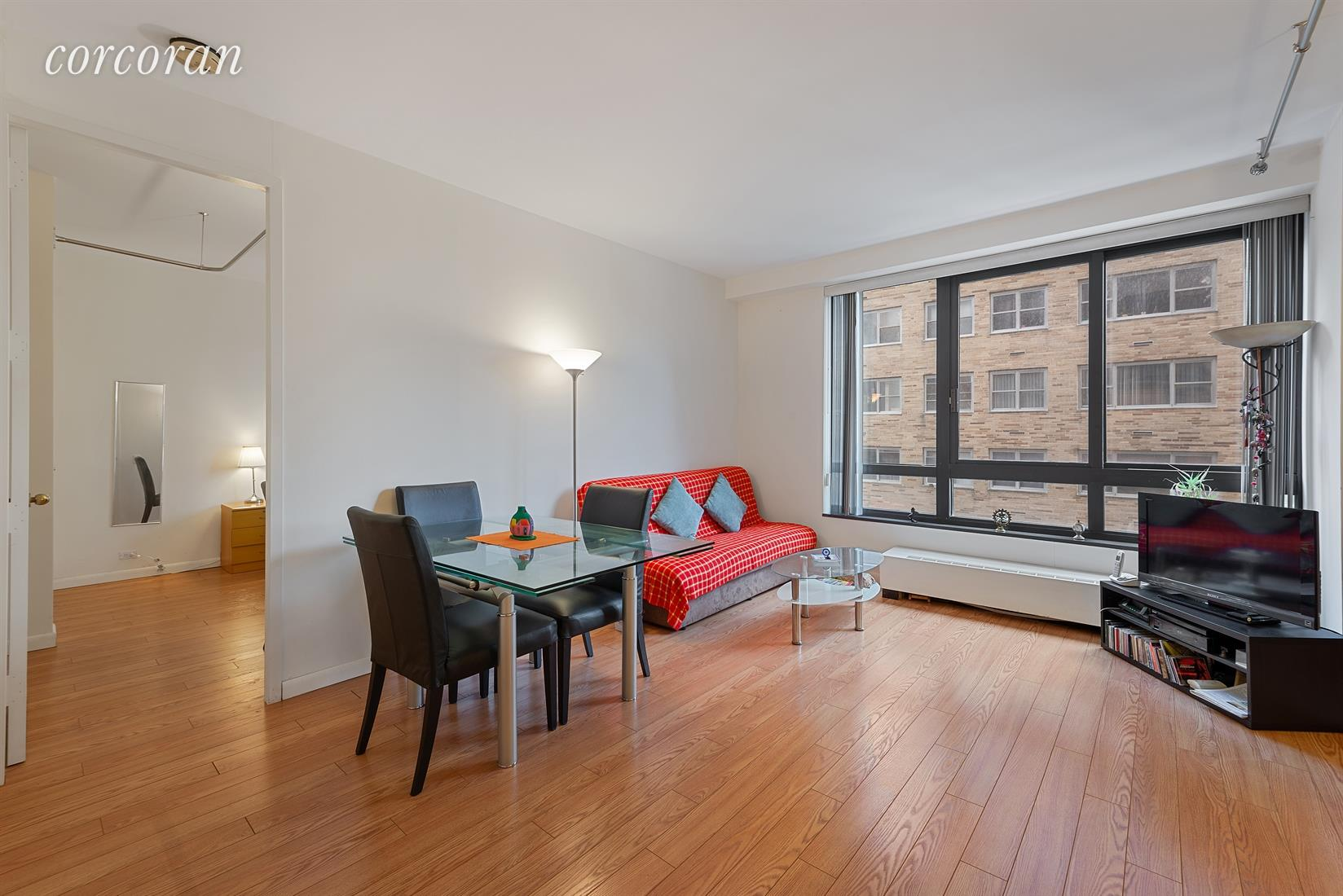 Fantastic one bedroom, one bathroom apartment available for sale at 100 United Nations Plaza. This quiet, spacious and functional unit has a large living room with a separate dining alcove, which could also be used as an office or sleeping area, with oversized north-facing windows. The galley kitchen has black and stainless steel appliances including a dishwasher and a new refrigerator. The large bedroom comfortably accommodates a king size bed and has an en suite marble bathroom with a Jacuzzi tub. Additional features of this unit include new hardwood floors, 3 extra-large closets and 9' ceilings.  Tenant in place through June 2021. Located on East 48th Street and First Avenue, 100 United Nations Plaza is a white-glove, full service condominium in Manhattan's Turtle Bay neighborhood. Greeting residents with beautifully landscaped gardens and waterfalls, this impeccably run building offers a 24-hour doorman, valet and concierge service, on-site management office, renovated lobby and resident's lounge, common laundry room, fitness center and direct access to a 24-hour attended parking garage. Conveniently located to transportation and many great shops and restaurants. Pet friendly (1 dog, maximum 50 lbs.)Showing by appointment only.