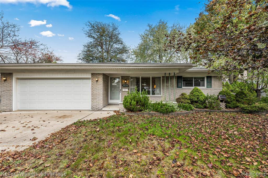 OPEN HOUSE Friday 4-6 and Sunday 1-3!  Lovely spacious ranch in Blue Grass Farms community w/3 bdrms and 1.5 baths. Quiet subdivision, great location with Livonia schools - close to schools, shopping and freeway. Oversized Family Rm w/vaulted ceiling, fireplace and doorwall that leads to composite maintenance free deck in nice fenced yard. Open concept kitchen opens to FR. Finished basement w/utility and lots of storage areas.  Sprinkler system to maintain your landscaping.  Priced accordingly to make this Livonia home your own. 1 year Home warranty included. Immediate occupancy.