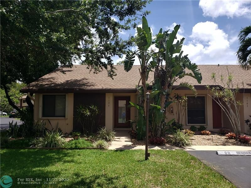 Beautifully updated 2 BR end unit Villa in gated Pines West! New kitchen cabinets with granite counters, new flooring throughout, vaulted ceilings, updated baths, quiet pavered patio area. Pines West features heated pool, full gym, fiber optic cable and high speed Wi-Fi included in association fees, and pet friendly! Easy access to restaurants and entertainment on Wilton Dr, Downtown, and the Beaches. With Low Interest Rates What Are You Waiting For? Welcome Home!