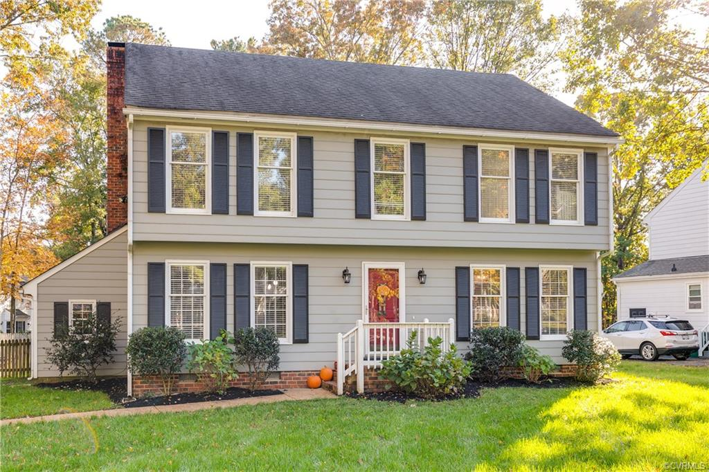 Lovely Colonial on large lot in the heart of Short Pump. Wood Floors throughout first floor, updated, bright kitchen with vaulted ceiling, skylights, spacious pantry, granite counters, two-toned cabinets and stainless appliances...gas range is a nice bonus!  Large family room with brick fireplace opens to great deck and huge back yard with detached storage shed. Formal living room  has been converted to an office with French doors. Formal dining room provides plenty of space for entertaining. Master suite features walk in closet, double sink vanity and private bath.  Restaurants and shopping are within very close proximity, excellent schools, fantastic location overall!  Come check it out, it's not going to last long!