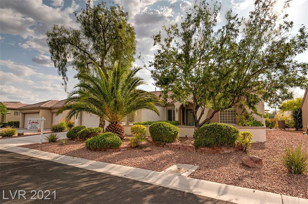 Beautiful hard to find Del Webb Anthem Arlington model,  Double Glass Doors 2,337sf single story. HUGE Great room, fireplace, entertainment center for BIG TV! Laminate wood look flooring in Grt Room, Kitchen & Bathrooms. Pullout shelves, Granite Countertops, Very large Owner's Bedroom w/ Bay Window, Covered patio, Crown molding, ceiling fans, Oversized lot 8,276 sq. ft..Oversized 2 car garage. Fridge, microwave included.